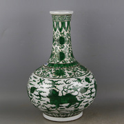 Emperor Wanli of the Ming green colored lion pattern flat bottle kiln ancient porcelain by hand antiques antiques unearthed in imitation ornaments