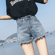 2018 new Korean version of the Hong Kong taste of the original flash chic denim shorts female high waist was thin wide leg loose hot pants