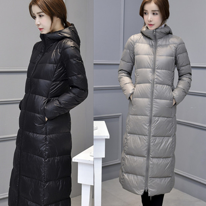 The anti season Korean new winter white duck down jacket fashion girls long slim knee extension thin coat