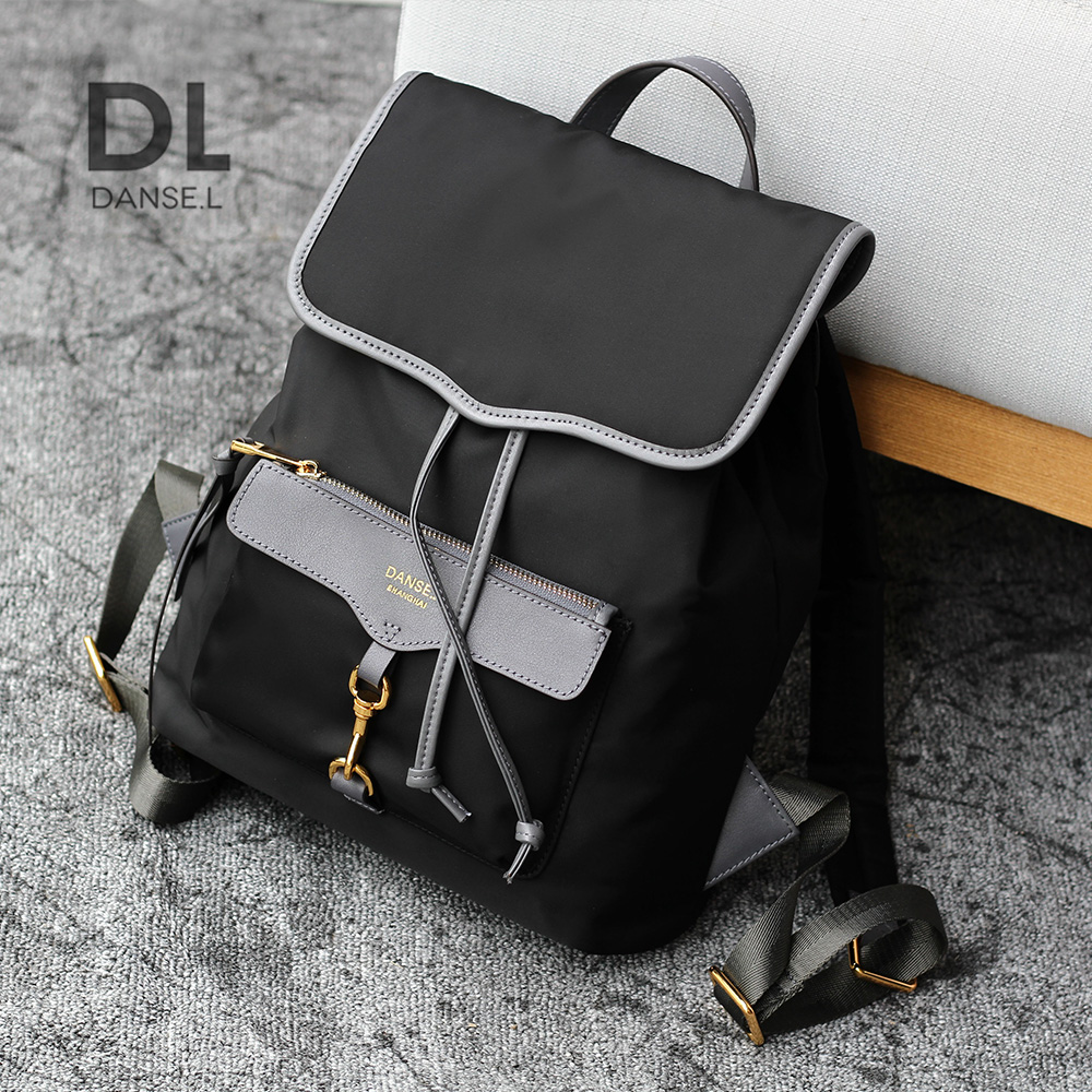 Korean version of backpack women surge backpack leather College wind business Oxford nylon school bags travel bags