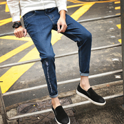 The new nine minutes of the young men's jeans in the spring young foot style Korean version of the hole Haren pants pants trend of 9 points