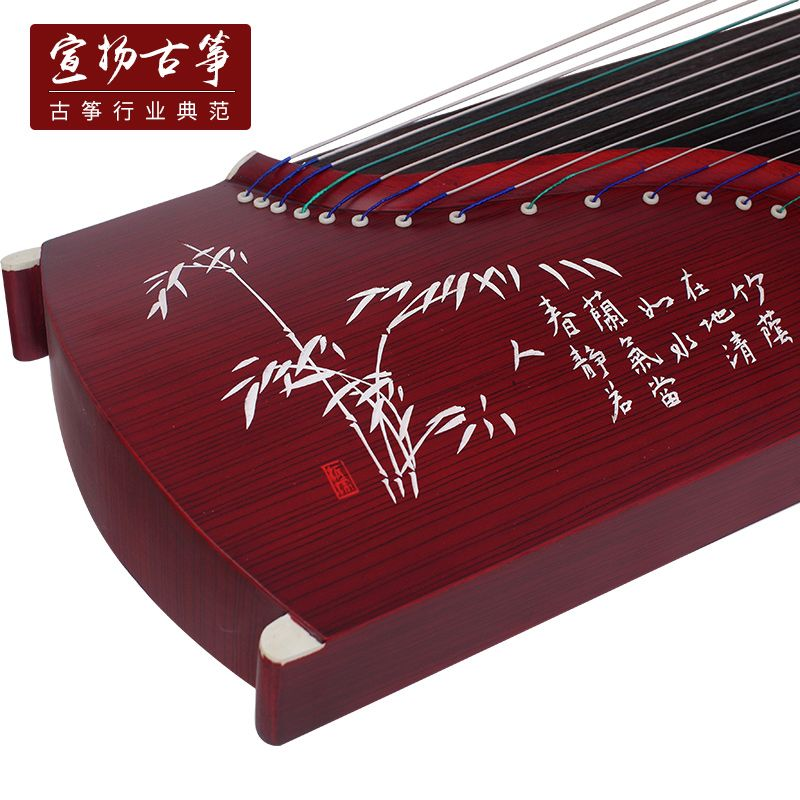 Open to booking a beginners professional learning to play the guzheng employs a full set of instruments Annatto ebony lettering