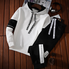 A new autumn and winter men's sportswear hooded hoodies and cashmere jacket suits students thickening