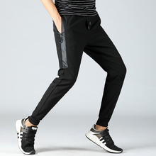 Sports pants men's summer thin section men's casual pants nine points loose pants male Korean version of the trend of feet pants harem pants