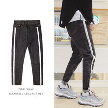2017 Hong Kong new winter wind pants jeans Metrosexual Korean washing slim slim denim trousers all-match