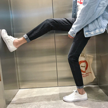 Black jeans slim male teenagers 2017 feet all-match stretch long pants trend Korea autumn