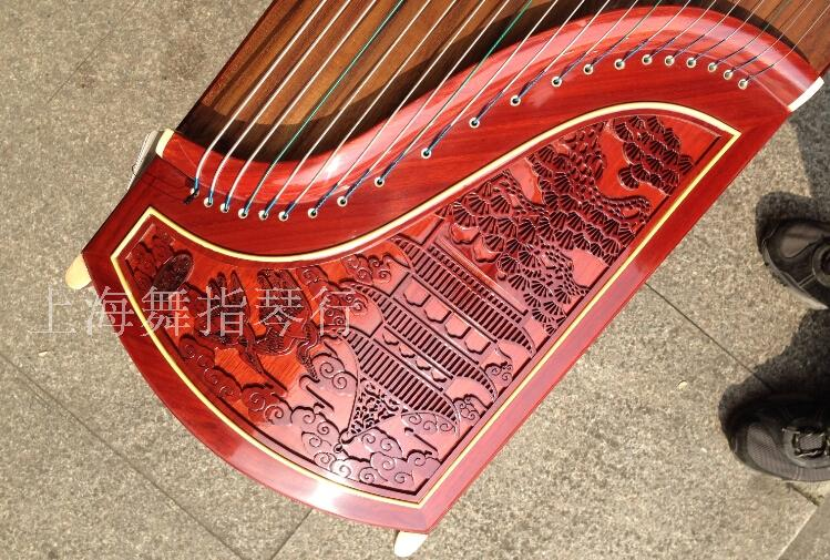 HaiDing rhyme guzheng 902 red rosewood/playing guzheng/James t. c. na was published on the floor