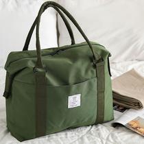 Travel bag hand luggage bag net red single shoulder short canvas travel bag Women large capacity messenger bag male