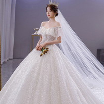 Word shoulder wedding dress 2021 new style court style luxury high-end sense large tail bridal main yarn covering thick arms summer