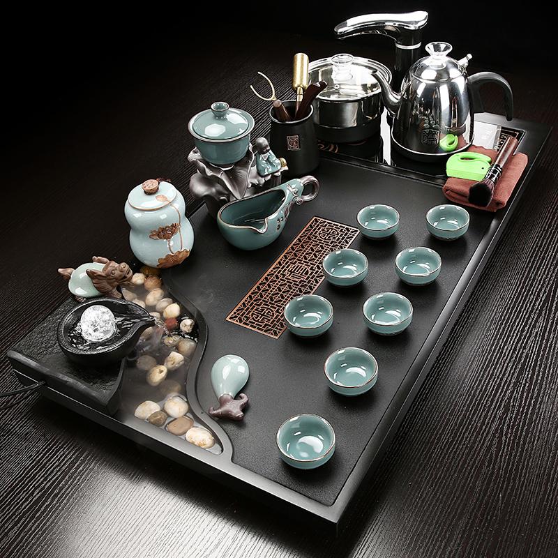 The whole piece of Wujin stone tea plate atomized flowing kung fu tea set group home large tea tea sequester ceramic purple sand teacout