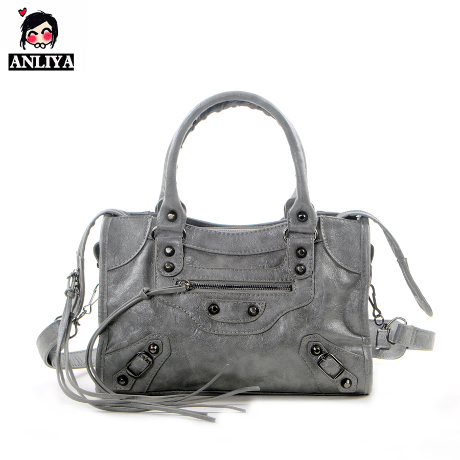 New Mini oblique Bag Korean version mini small Q version medium and small tasseled locomotive bag single shoulder oblique straddle female bag