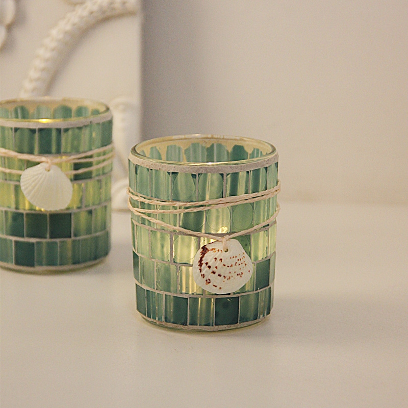 Mediterranean 繫 adorned with shell glass mosaic candles and romantic candlelight dinner candles
