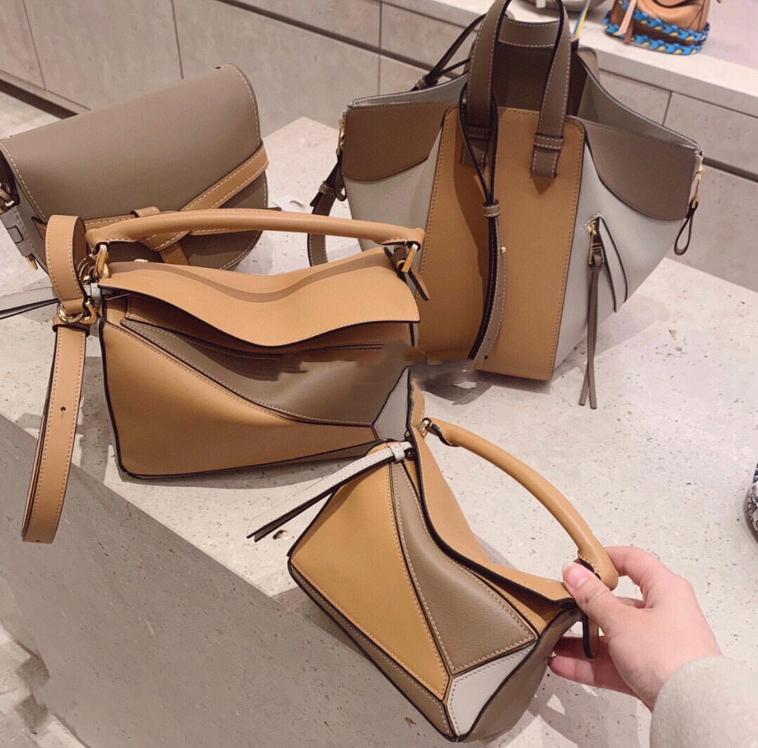 Gold word-of-mouth old shop ingenious quality Recommended One-shoulder oblique cross-hand leather lady geometric bag