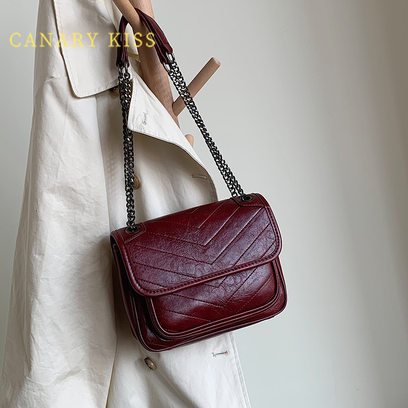 Red retro high-end feel under the bag girl summer 2021 new fashion niche design one-shoulder stiletto bag