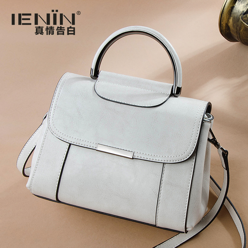 Bouquet Women's 2019 New Korean Version Small Bag Fashion Retro Hand-held Single Shoulder Simple Atmospheric Slant Bag Genuine Leather Women's Bag