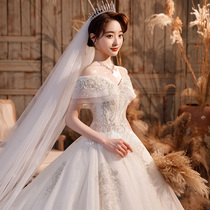 One-character shoulder main wedding dress 2021 new bride Palace wind heavy industry luxury high texture big tailing tail covering thick arm