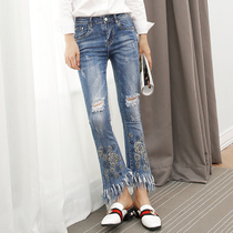 Spring high elastic micro-hole stretch flare jeans women irregular fringed printing nine pants Korean version of the Jokers left bank